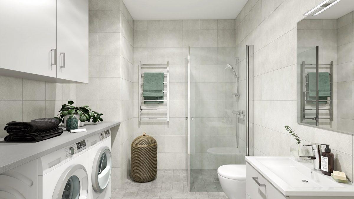 Sobert badrum med tvättmaskin och torktumlare
