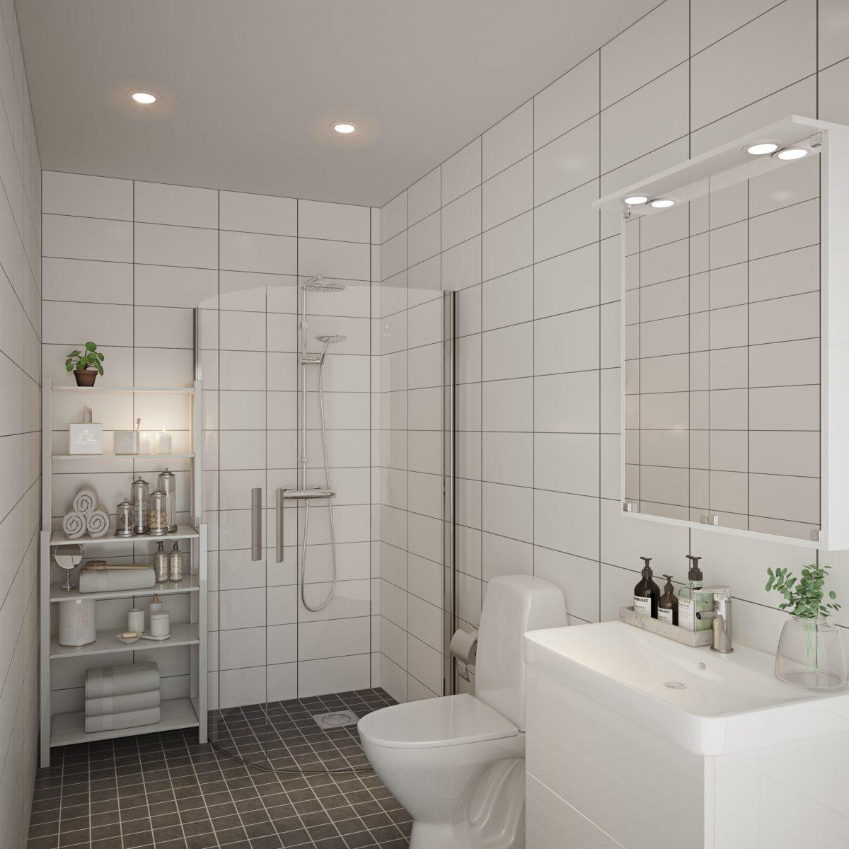 Badrummen är helkaklade med infällda spottar